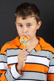 Boy eating lollipop Royalty Free Stock Image
