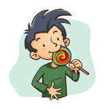Boy Eating Lollipop Candy Stock Image
