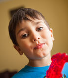 Boy Eating A Lollipop. Close Up of Young Boy Eating A Lollipop. Focus on the eyes Royalty Free Stock Photos