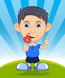 The boy is eating a lollipop Royalty Free Stock Image