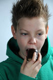 Boy eating marshmallow Stock Images
