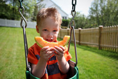 Boy eating melon Royalty Free Stock Image