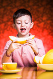 Boy eating melone Stock Photography