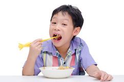 Boy eating noodle by chob stick Royalty Free Stock Photos