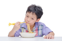 Boy eating noodle by chob stick Stock Photography