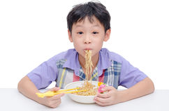 Boy eating noodle by chob stick Stock Image