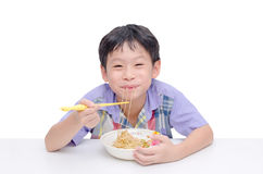 Boy eating noodle by chob stick Royalty Free Stock Photo