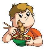 Boy Eating Noodle Stock Photo
