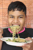 Boy Eating Noodle Royalty Free Stock Photos