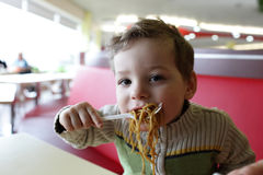 Boy eating noodles Royalty Free Stock Images