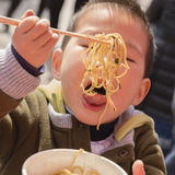 Boy eating noodles Royalty Free Stock Photography