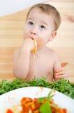 Boy eating noodles Royalty Free Stock Photos