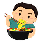 Boy eating noodles using Chopstick Royalty Free Stock Photos