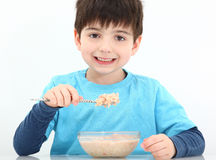 Boy Eating Oatmeal Stock Photography