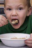 Boy Eating Oatmeal Big Bite Royalty Free Stock Image
