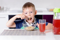 Boy Eating Oatmeal Cereal for Breakfast Royalty Free Stock Photography