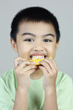 Boy Eating Orange Slice Royalty Free Stock Photos