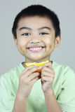 Boy Eating Orange Slice Royalty Free Stock Photography