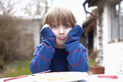 Boy Eating Outdoors Royalty Free Stock Photo