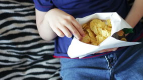 Boy Eating Packet Of Potato Chips unhealthy food stock footage