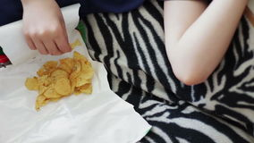 Boy Eating Packet Of Potato Chips unhealthy food stock video