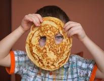 Boy is eating pancake Royalty Free Stock Photo