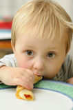 Boy eating pancake Royalty Free Stock Photos