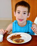 Boy eating pancakes Royalty Free Stock Photography