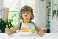 Boy eating pasta Royalty Free Stock Image
