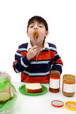 Boy Eating Peanutbutter Stock Images