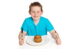 Boy eating pie. Boy eating pork pie. Studio white background Royalty Free Stock Photos