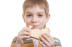 Boy eating piece of bread Royalty Free Stock Image