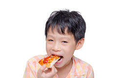Boy eating a piece of pizza Stock Photo