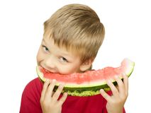 Boy eating a piece of watermelon Stock Photography