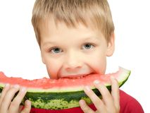 Boy eating a piece of watermelon Stock Photo