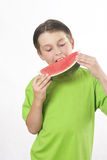 Boy eating a piece of watermelon Stock Image