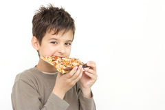 A boy eating pizza. Slice isolated on a white background stock photo