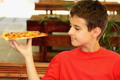 A boy eating pizza Royalty Free Stock Photos