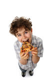 Boy eating pizza. Isolated on white background stock photos