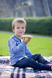 Boy, eating pizza in the afternoon Stock Image