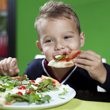 Boy Eating Pizza Royalty Free Stock Photos