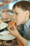 Boy eating pizza Royalty Free Stock Image