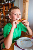 Boy eating pizza Royalty Free Stock Photo