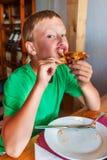 Boy eating pizza Royalty Free Stock Photo