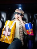 Boy Eating Popcorn In 3D Movie Theater Royalty Free Stock Images