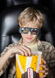 Boy Eating Popcorn While Watching 3D Movie Royalty Free Stock Photo