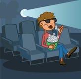 Boy eating popcorn Stock Photos
