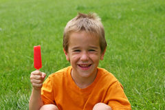 Boy Eating Popsicle. Boy with big smile about to eat a popsicle Royalty Free Stock Photos