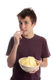 Boy eating potato crisps Royalty Free Stock Photo