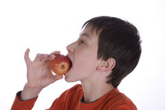 Boy eating red Apple Stock Photos